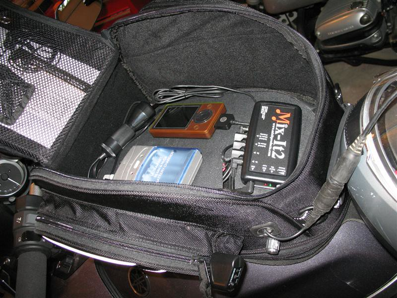 Still plenty of room for all the normal stuff we carry in the tankbag.  I set the Zune to shuffle through the tunes, so don't invite distractions by having the Mp3 controls too handy.  Ipod makes a slick remote for those units which is an idea.