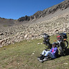 Today's adventure window goal is reaching the spine.  We pack hiking shoes in our kit to avoid scrambling in motocross boots.  Both of us need more high elevation time.  Jeannie sits and enjoys a perfect blue sky day at 12,400 feet.  The bikes are running well.
