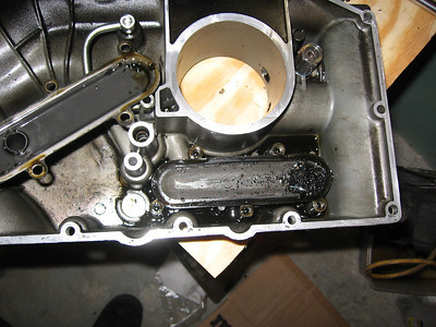 Oil pickup filter/screen in the sump.  Look at the junk!