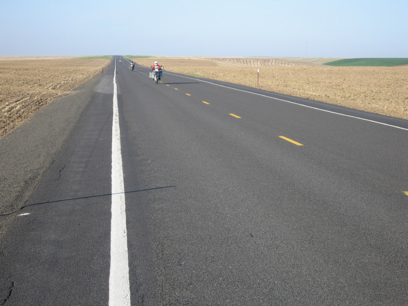 Eastern Washington country roads - the ideal place to practise your throttle wrist. Kevin approaching.