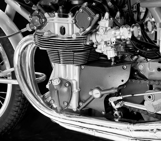 1959 Honda RC 160. This DOHC air-cooled four made 35 hp at 14,000 rpm. This was Honda's first four cylinder DOHC engine. It had a 5 speed transmission and 4 carbs (Honda Collection Hall).