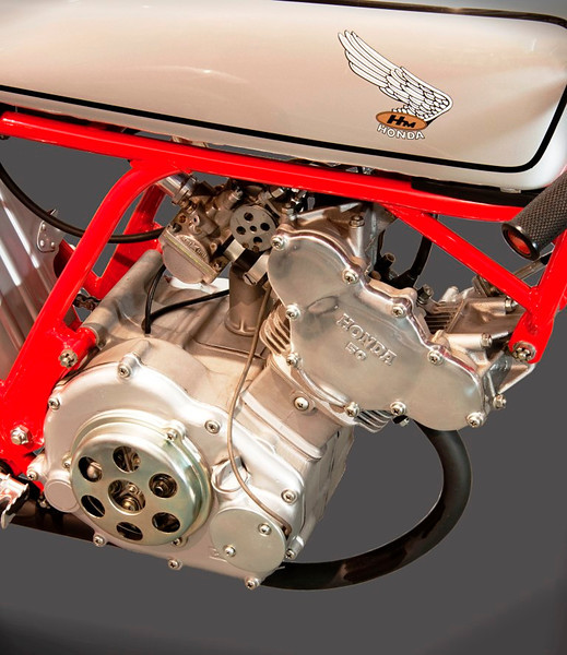 1962 Honda CR100 Cub 50cc. It produced an amazing 8.5 hp at 13,500 rpm, achieving 130 km/hr. (Honda Collection Hall).