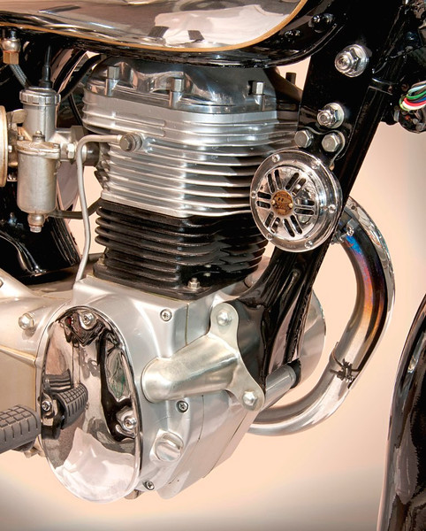 1955 Honda OHC 246 cc single. Note the pressed metal frame, instead of tubular structure. It put out 10 hp for a 4-speed transmission. (Honda Collection Hall).