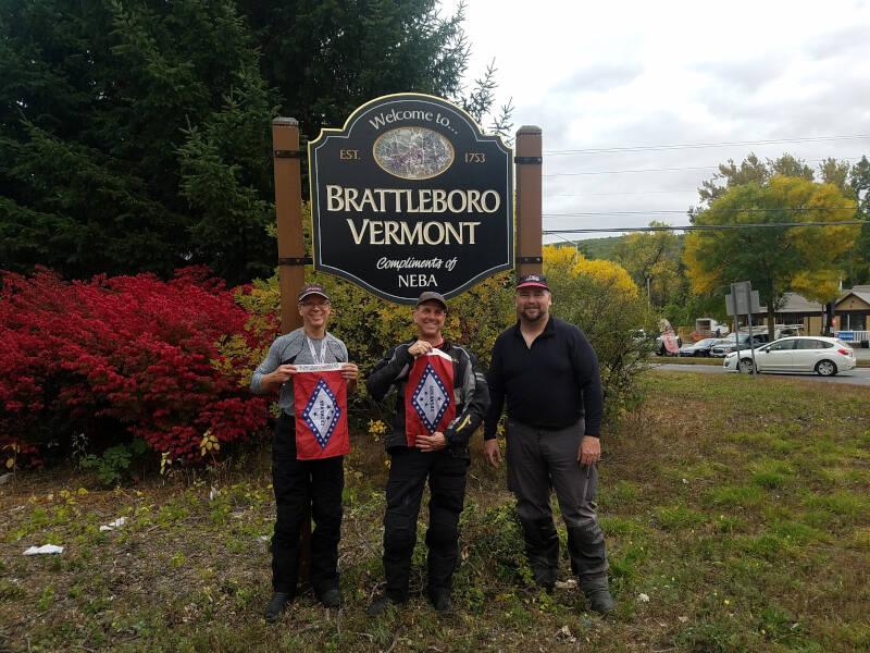 posing by Brattleboro sign