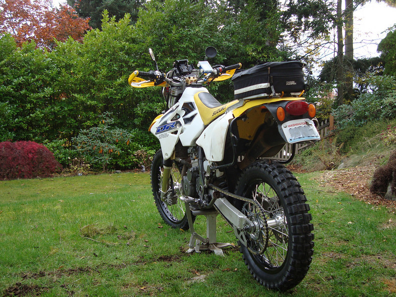 Suzuki DRZ400S. Small bore dual sport bike with a setup for single and wide track riding. Installed is a 3 gallon fuel tank, 14/52 gearing, and light rear tail bag.