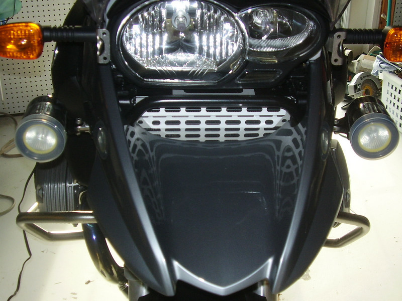 "Trail Tech SCMR 16 HID with internal ballasts. Mounted to the tubular sub-frame under the front fender using Trail Tech horizontal frame mounts. Advantage is when the bike falls over the lights rotate out of the way.<br /> <a href=""http://trailtech.net/single_hid_scmr16.html"">http://trailtech.net/single_hid_scmr16.html</a><br /> <a href=""http://trailtech.net/frame_mounts.html"">http://trailtech.net/frame_mounts.html</a>"