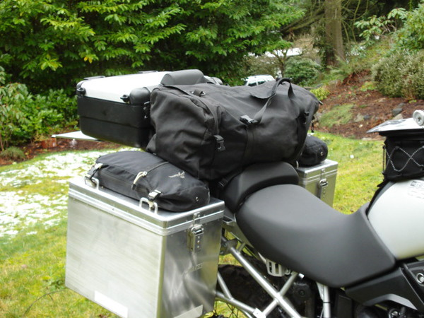 """Pic shows Duffle bag via Dirt Bagz with under bag straps for attaching to bike.<br /> <a href=""""http://www.dbzproducts.com/extras.htm"""">http://www.dbzproducts.com/extras.htm</a>"""
