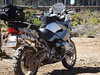 BMW R1200gs - w/daily riding setup;  tool bag under tail rack, and right side round tool carrier. Tool carrier holds all of the BMW tools needed to break down 60% of the bike. Tool bag holds oil, electrical and emergency tape, extra turn signals, and light bulbs. Other bags hold warm and rain clothes, emergency & medical kit, snacks and water.