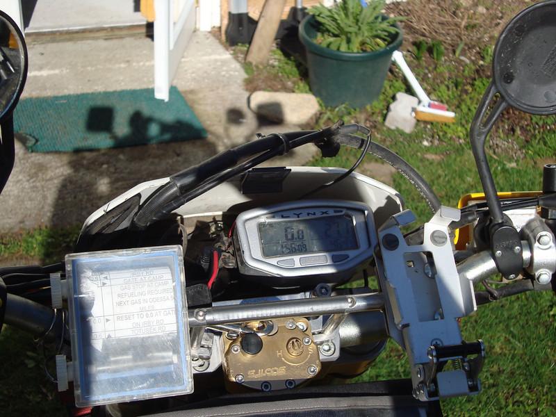 DRZ400S; R-L; Roll chart holder, Scott Dampner, Trail Tech Enduro computer, TT GPS holder.