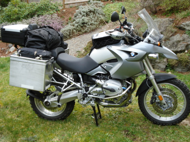 Standard camping kit; TT panniers-Left is 35 liters, right is 41 liters, tail box expands to 42 liters., Osprey crampon bags on pannier lids, BMW expandable tail box, In the duffle, Dirtz duffle modified to store a Camp Time Fold-a-Table 25x25x25 table, folding Kermit chair, rain gear, and various other camp gear. This kit provides for self contained camping for several nights.