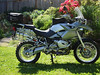 R1200gs standard components; Wilber Suspension, Touratech (TT) engine gaurds, TT pannier racks, TT rear fender, Neslon Rigg expandable tail bag, GT-Moto tool carrier, Acerbis Rally hand guards, heated hand grips, BMW computer, ABS, ASC, wired for heated clothes, TKC80 knobby tires,