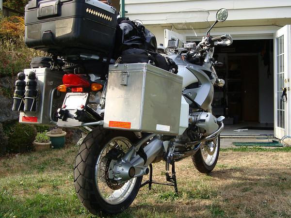 Pic shows Helmet locks on license plate, two SIGG 1 liter water bottles, touratech under the rack accessory bag (just above rear light), and a gas siphon pump attached to the inside of the right pannier.