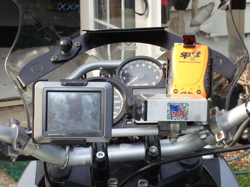 Counsole area hosts a Garmin Nuvi 550 GPS, route chart holder, and a SPOT satellite tracking device