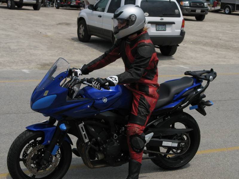 For my birthday I got to spend two days riding the track at the Virginia International Raceway.  Here's me, suited in the leathers I borrowed from our neighbor Gus, on my Yamaha FZ6, taped and tweaked for the track.