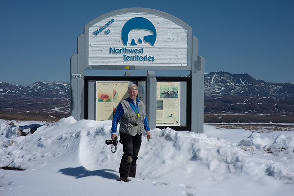 Anne at the border between the Yukon and Northwest Territories