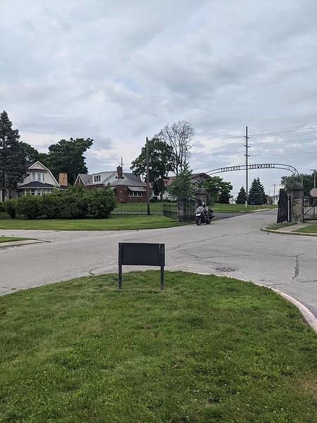 rider entering cemetery