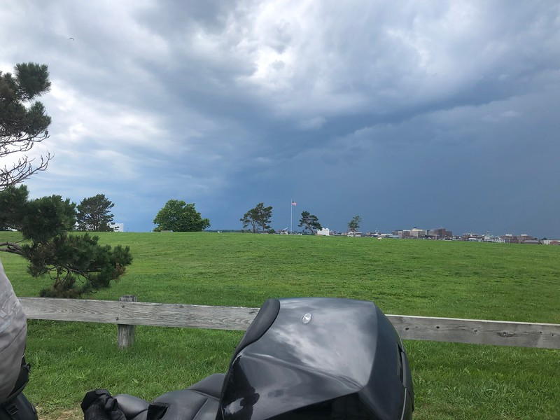 darkening storm clouds over Portland