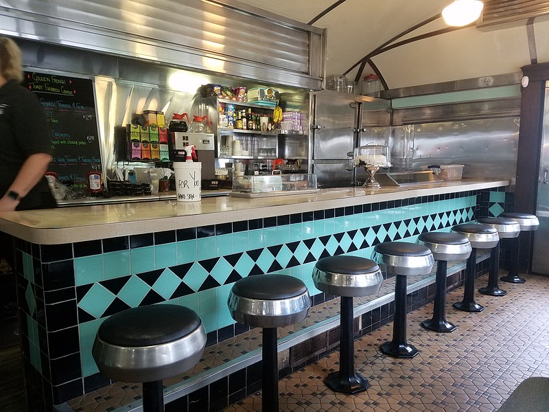 counter stools and tile work in the Historic Village Diner