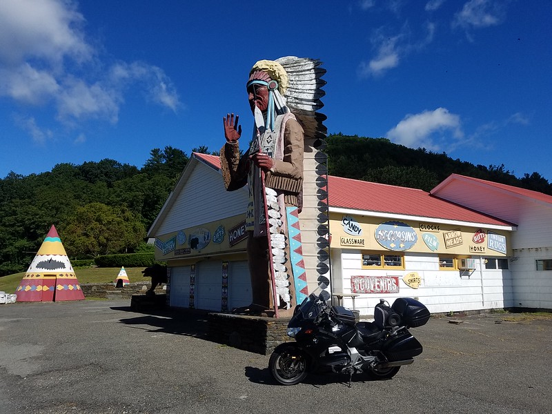 trading post with big Indian statue