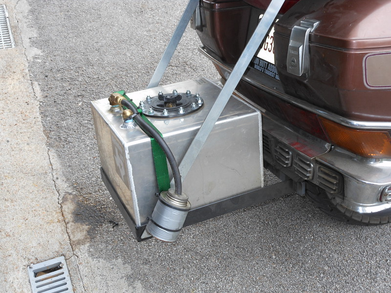 5 Gallon Summit Aux tank. Fuel is fed by an Airtex pump through a check valve and into the line between the gas tank and the OEM fuel pump. Fills the main tank in about 5 minutes.