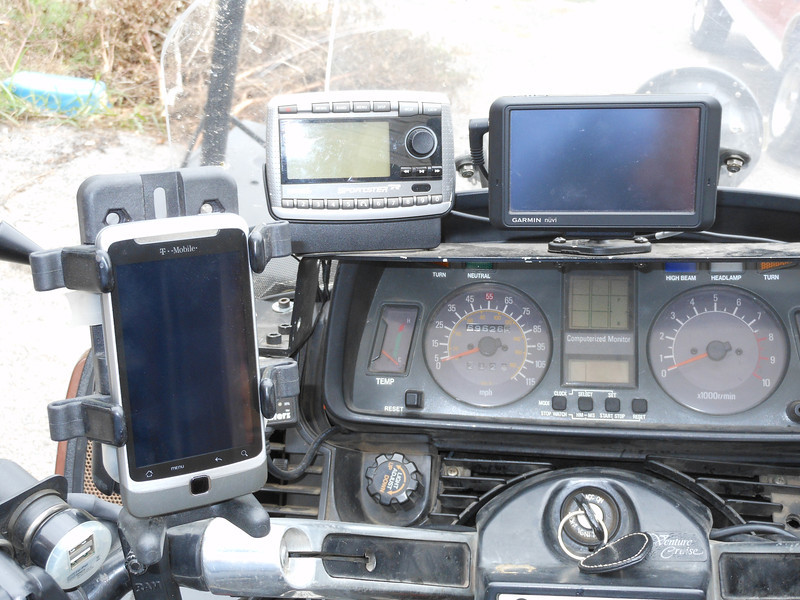 Phone mount, Satellite Radio and primary GPS. I made the shelf. Power outlets on top of clutch reservoir.