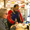 Carol grabs a quick cup of hot tea while Slava makes notes.
