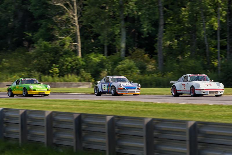 (left) 1973 Porsche 911, (middle) 1973 Porsche 911 RSR , (right) 1973 Porsche 911
