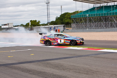 Simon Worthington's Bentley Continental GT slides across the track after a mechanical failure on the start finish straight.