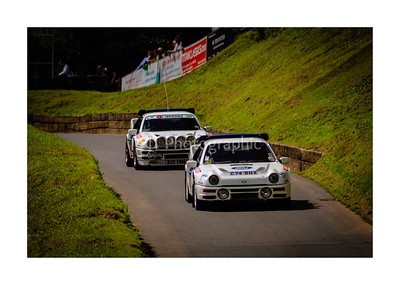 Pair of Ford RS200s returning down the hill in formation