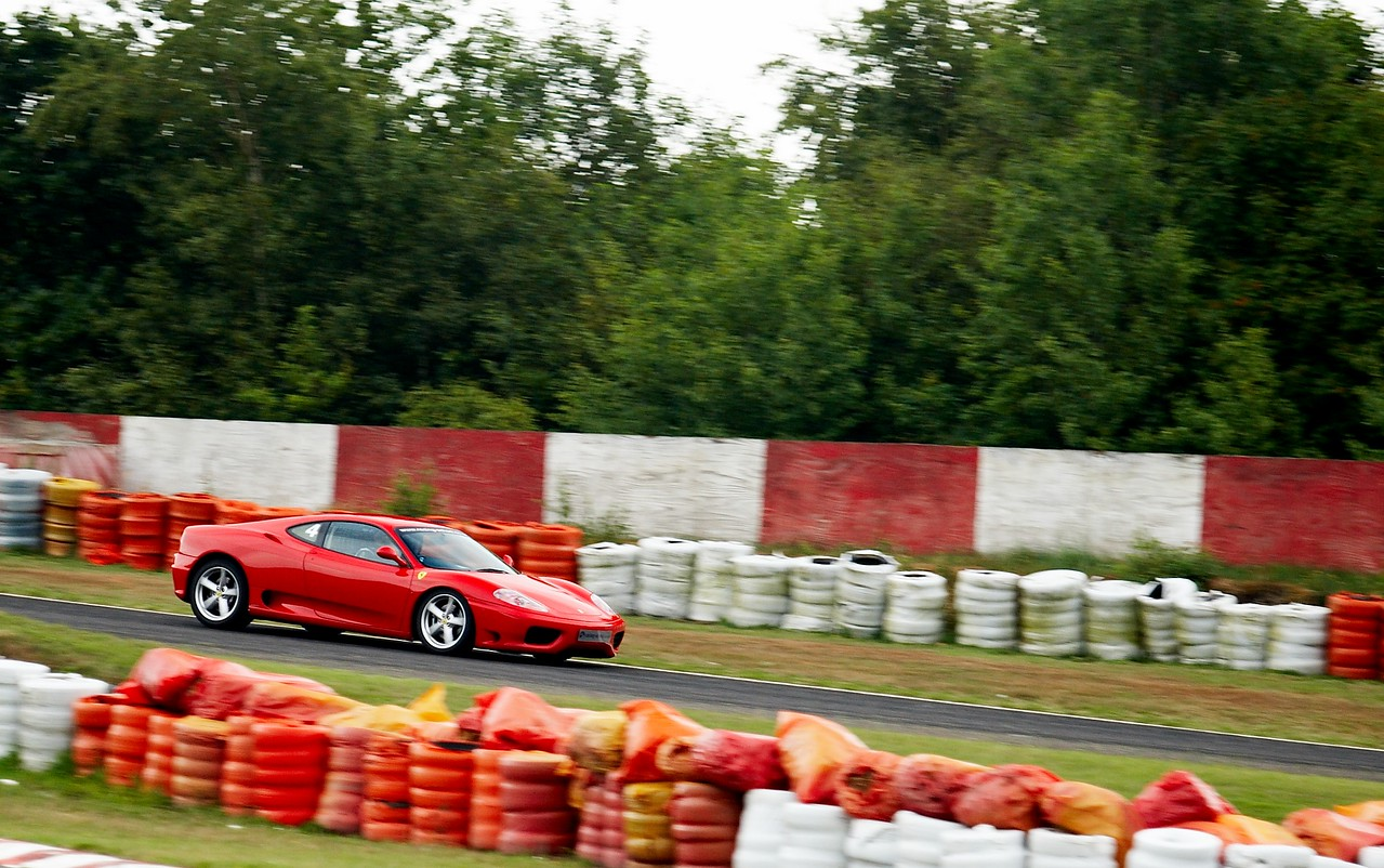 Ferrari 360? Yes please. This was one of the highlights of the day. The F360 was an absolute ball of fun. It was quick, sounded amazing, brakes were ok and it responded so well to being told to do stuff... I only got it sideways twice :-). Again I found myself picking through some of the other drivers out on track. I'll never own a car this expensive and this was the first time I had driven a $150000 car. It was about a 2002 model and had a traditional 6 speed manual box - no flappy paddle shifting here. The instructor here had his own brake pedal and was holding an engine kill switch the whole time. Fun.