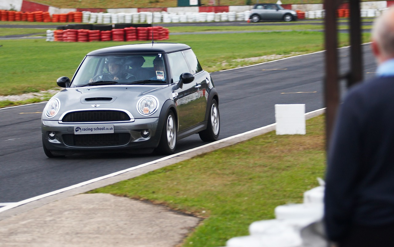 So first up was the Mini. I have driven a lot of Minis, although this was the first time driving a new shape one... It really wasn't that quick or exciting, but I managed to impress the instructor sufficiently so that his only feedback was that I missed a couple of apexes. The other drivers all got through ok - a few people were plainly there just for the experience and even at this stage appeared quite daunted. Despite the cars being spaced out, and only a couple of cars on the track at once, I caught and passed many of the other drivers during this stint. Well, by passed, I mean I caught them up and the instructor radioed the cars in front to move over!<br /> <br /> That was fun... what next?