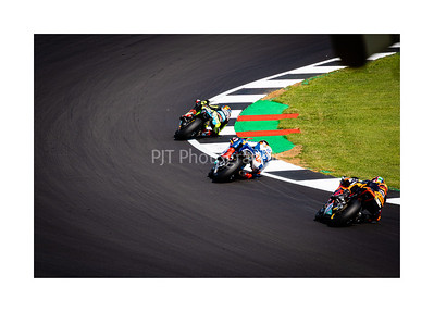 Jorge Navarro, Augusto Fernandez and Brad Binder leaning through Abbey