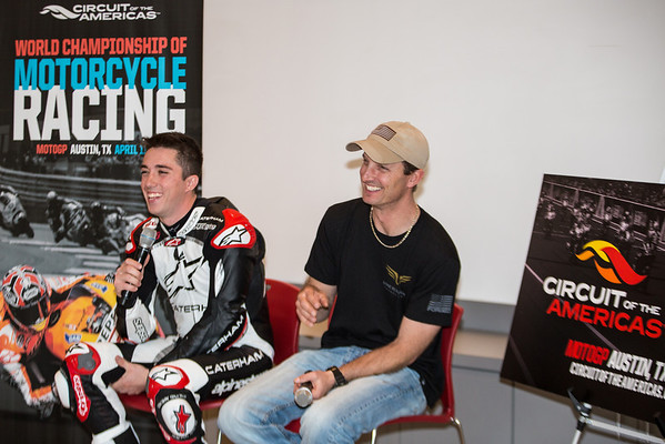 23 January 2014, Circuit of the Americas, Austin, TX: Moto2 rider Josh Herrin (left, USA - Caterham Moto Racing Team) and  MotoGP rider Colin Edwards (right, USA - NGM Mobile Forward Racing Team) laugh after answering a question at a press event at Circuit of the Americas for the MotoGP weekend coming April 11-13, 2014.