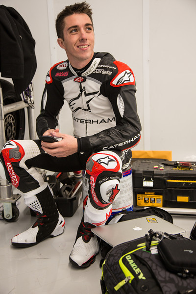 23 January 2014, Circuit of the Americas, Austin, TX: Moto2 rider Josh Herrin (USA - Caterham Moto Racing Team) warms up in the garage between brief stints of 2-4 laps due to the cold weather; during a press event at Circuit of the Americas for the MotoGP weekend coming April 11-13, 2014. The weather was cold; temperatures dropped during the event from the low 40s F (6 C), winds were around 25 mph, with gusts to 40 mph. As this was a press event and not a test session, Josh Herrin was on Yamaha R6 motorcycle, not his Moto2 race motorcycle.