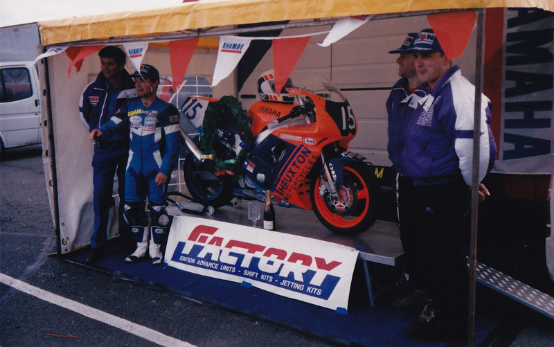 After winning the National Supersport Championship race at Donington Park in 1995. Thruxton Motorcycles Yamaha FZR600R.  L-R: Tony Holland, Adam Lewis, Jez Holman, Simon Green