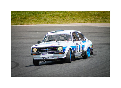 Ford Escort mk2 powering out of a bend