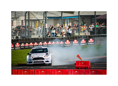 Elfyn Evans smoking a MSport Ford Fiesta WRC