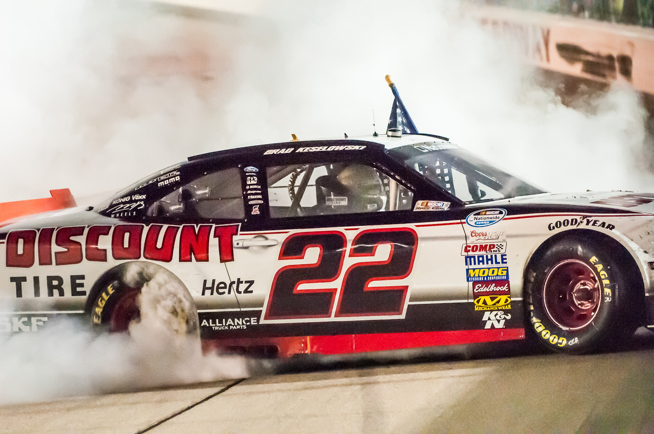 Brad Keselowski's victory burn-out in his #22 Ford, driving for Discount Tire & Roger Penske at the NASCAR Nationwide Series US Cellular 250 at The Iowa Speedway on Saturday, August 3, 2013. - Michael Gatzke