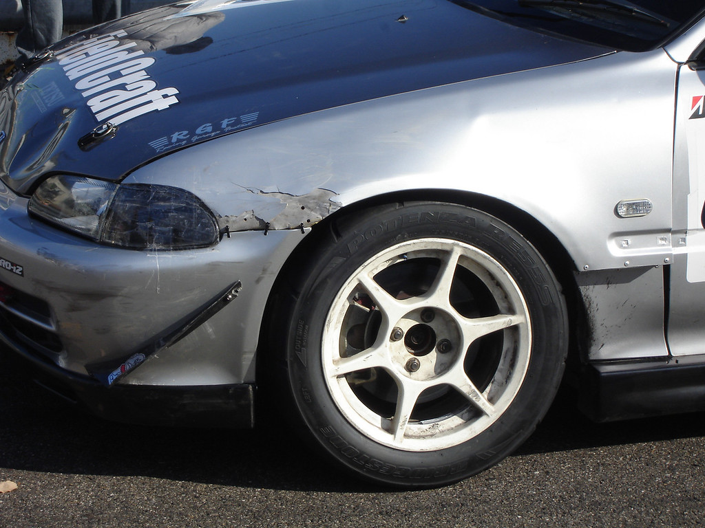 old battle scars on some of the cars before the race
