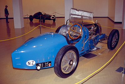 I think this is a Bugatti T35B.  Cars on display in museum adjacent to track.