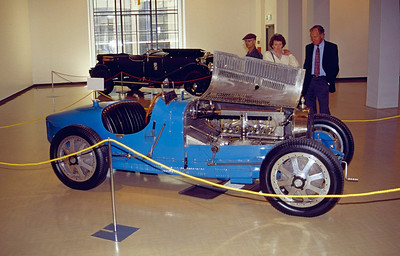 I think the blue car is a Bugatti T35B.  Cars on display in museum adjacent to track.