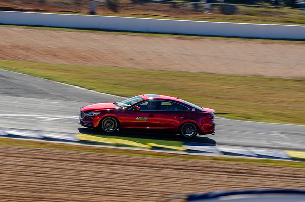A Hot Lap in a Mazda6.  The paint looks just as good as their race cars.