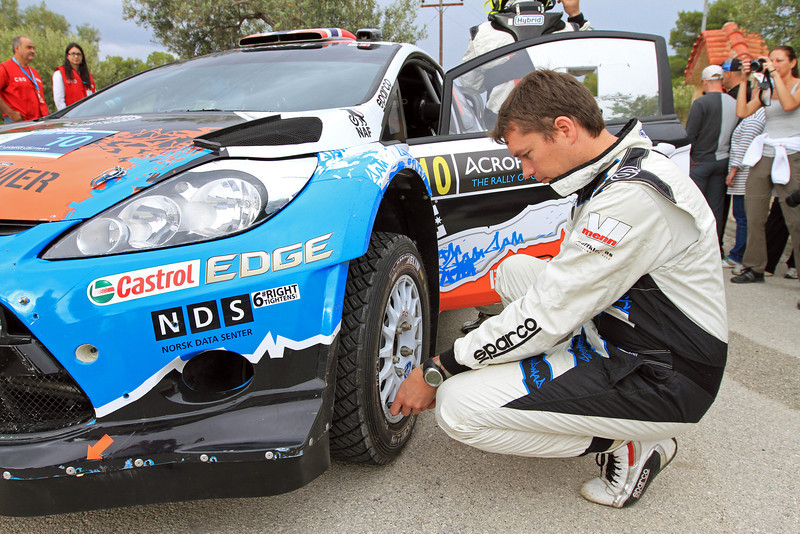Jonas Andersson checks the tyre pressures on Mads Ostberg's Ford Fiesta RS WRC, Qualifying.
