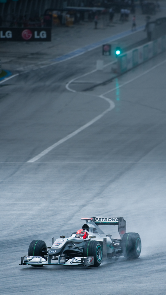 F1-1 Malaysia, Sepang 2010 <br /> Michael Schumacher - in the rain during Saturday Qualifying.