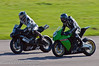 Matthew Billington (Triumph Daytona) dives inside Paul Willis (KTM RC8 1149)