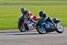 Adrian Martin (Yamaha TZ250) dives inside Colin Wilcock (Yamaha TZ 250)
