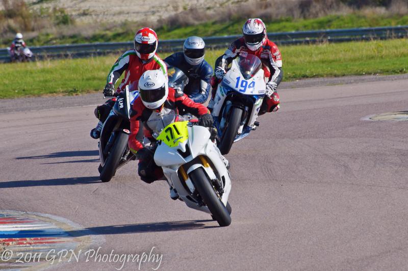 Jody Lees (Yamaha R6) leads Max Symonds (Triumph 675) another rider and Bill Callister (Kawasaki ZX6R)