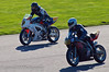 Matt Page (Suzuki SV650) sweeps around the outside of Sebastian Kelly (Suzuki SV650)