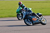 Paul McCullagh (Yamaha TZ 250) sweeps around the outside of Gary Vines (Honda RS 250)