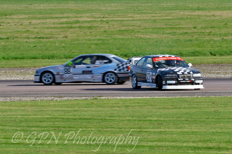 Paul Bellamy (BMW 318is) passing Evelyne Buanic (BMW E30 M3) having a spin - Kumho BMW Championship